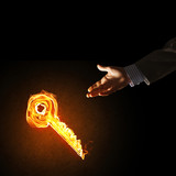 Concept of partnership and cooperation presented by fire glowing key icon