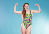 Strong woman girl in swimsuit showing off muscles. - 205650788