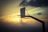 basketball basket against sunset sky