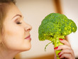 woman holding broccoli vegetable