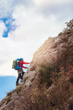 Climbers reaches the top of mountain peak. Climbing and mountaineering sport