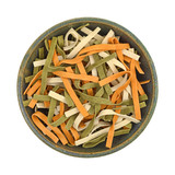 Top view of vegetable noodles in an old stoneware bowl on a white background. - 205675373