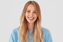 Optimstic Cheerful Young Female Model  Positive Smile Rejoices Having Weekend Has Delighted Expression Wears Casual Clothes Poses Against   Happy Blonde Woman Poses Indoor Sticker