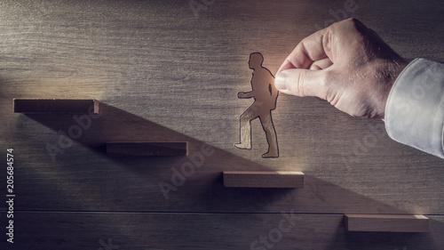 Retro toned image of a business man climbing steps towards the light