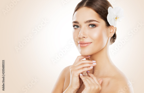Woman Beauty, Face Skin Care and Natural Make Up, Girl with Orchid Flower in Straight Hair, Beautiful Makeup and Skincare
