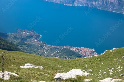 Fotobehang Blauwe jeans Panorama of the gorgeous Lake Garda surrounded by mountains in Monte Baldo Macesine, Provincia di Verona, Veneto, Italy