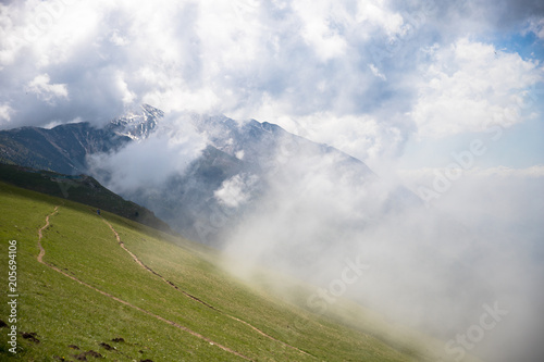 Fotobehang Wit Panorama of the gorgeous alps mountains Monte Baldo mountain and white clouds Macesine, Provincia di Verona, Veneto, Italy