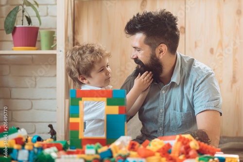 The boy touches his father's beard. An example and love. Tender feelings, family love. A good father. Father's Day. The son and father spend time together at home. A caring parent