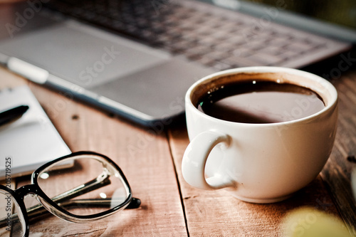 Desk work coffee cup and laptop notebook pen on wooden table - 205719525