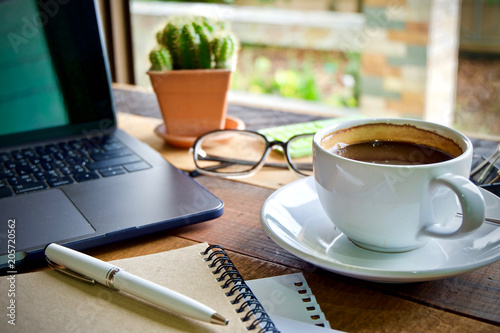 Desk work coffee cup and laptop notebook pen on wooden table
