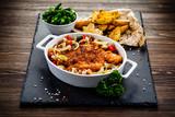 Fried pork chop with vegetables on wooden background  - 205722134