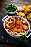 Fried pork chop with vegetables on wooden background  - 205722146