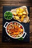 Fried pork chop with vegetables on wooden background  - 205722169