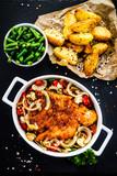 Fried pork chop with vegetables on wooden background  - 205722180