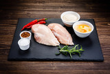 Raw chicken fillet on wooden table  - 205722198