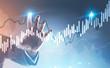 Businessman hand touching a graph hologram - 205726527