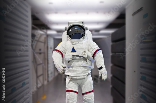 Plexiglas Heelal Astronaut pressure suit in a space shuttle cockpit ( NASA image not used )