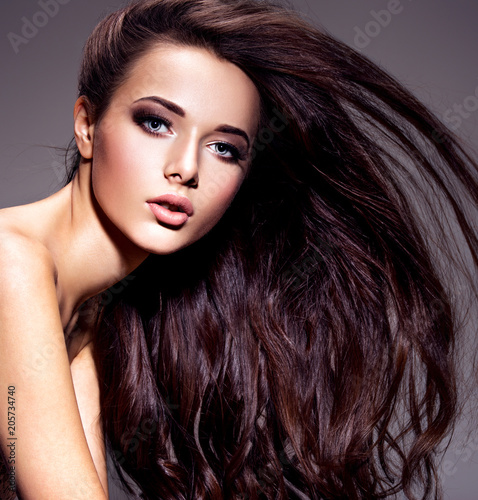 Fotobehang Kapsalon Portrait of the beautiful young woman with long brown hair