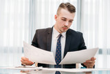company executive, business analyst or corporate manager working in office. documents review, paperwork concept - 205741361
