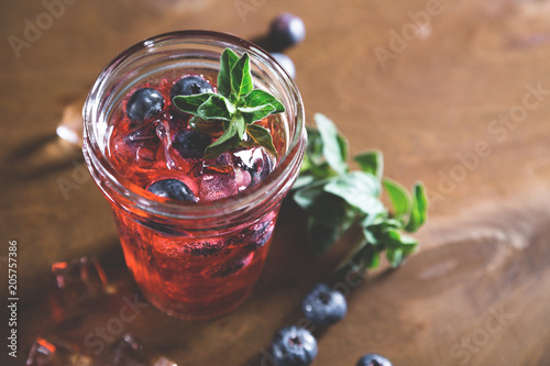 Fototapeta Natural lemonade with fresh blueberries and herbs
