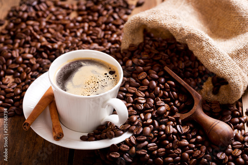 Wall mural cup of coffee and coffee beans in a sack