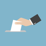 Hand putting paper in the ballot box. Voting concept. - 205774318