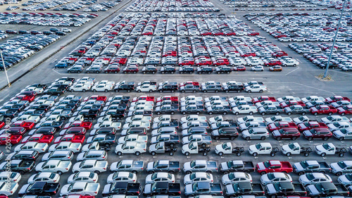 Leinwanddruck Bild Aerial top view new car lined up in the port for import and export, New car business logistic and transportation to dealership.