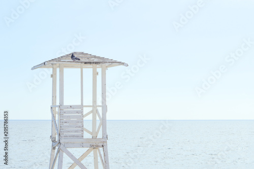 A white wooden lookout lifeguard tower.  - 205786353