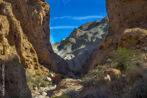 Fotobehang Chocoladebruin Rainbow Basin Mojave Desert Slot Owl Canyon