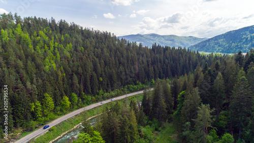 Fotobehang Bergrivier Aerial view of mountain road in summer.