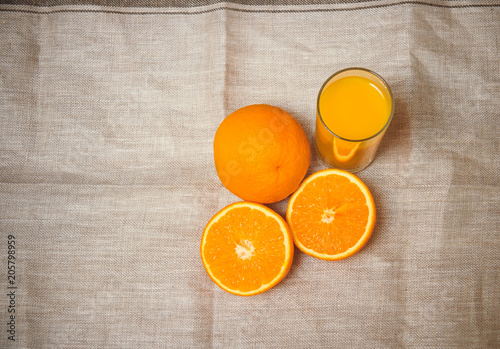 Orange juice and oranges. Top view with copy space.