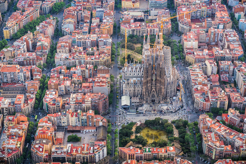 Barcelona aerial view, Eixample residencial district and Sagrada familia, Spain. Late afternoon light