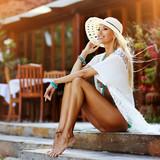 Beautiful woman in hat outdoor portrait - 205803982