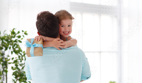 Father's day. Happy family daughter hugging dad and laughs