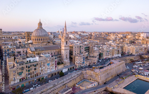 Obraz na płótnie Aerial view of the main Cathedral in Valetta, Malta. Flying over the ancient town with many old buildings and Catholic church in the center.