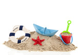 Beach with life buoy and toys