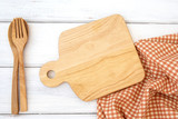 chopping board and tablecloth with wooden fork and spoon on white table , a  recipes food  for healthy habits shot note background concept - 205821961