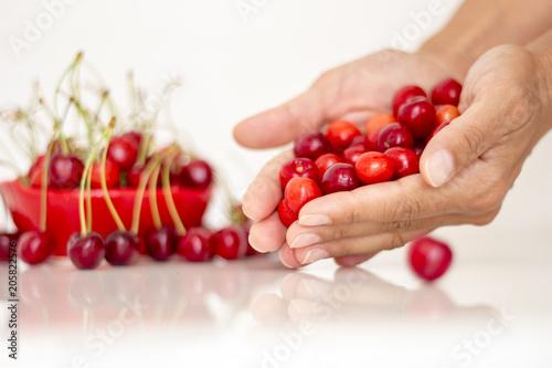 Foto Murales  A handful of cherries in a cherry basket A cherry in a handful of cherry fruits A cherry in a handful of fruits