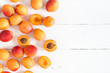 Leinwanddruck Bild - Apricots on white wooden background. Flat lay, top view, copy space