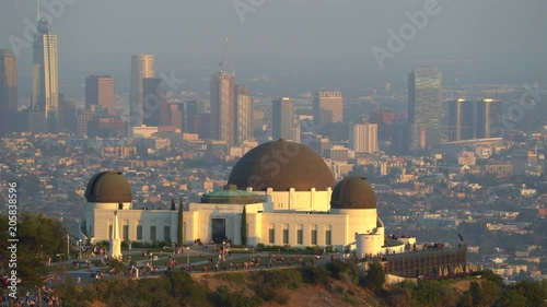 Griffith Observatory building and downtown Los Angeles cityscape at sunset - August 2017: Los Angeles California, US