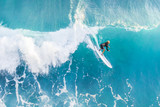 Surfer on the crest of the wave, top view - 205839751