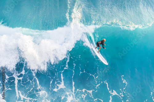 Fototapeta Surfer on the crest of the wave, top view
