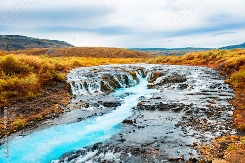 Bruarfoss waterfall with blue water in Iceland.