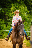 Cowgirl doing horse riding on countryside meadow - 205844580
