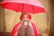Quadro Girl sitting in park with umbrella