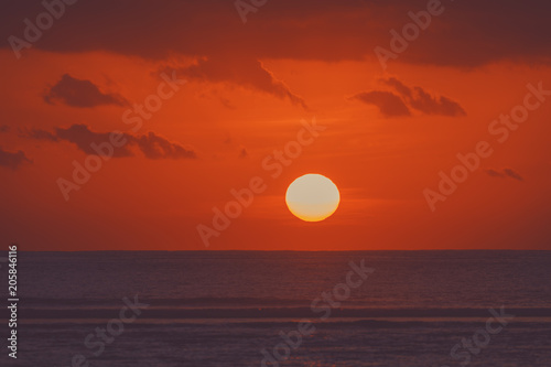 Fotobehang Rood traf. Sunrise over ocean horizon photographed with big telephoto lens.