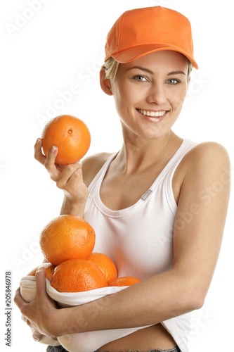 Young woman with fresh oranges