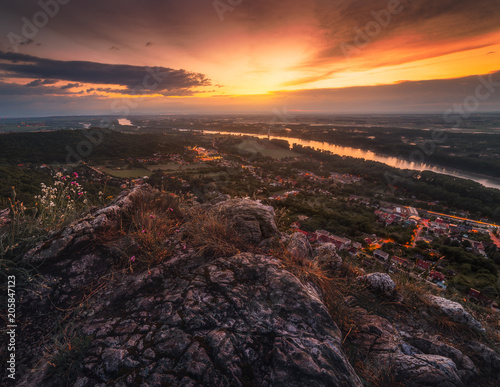 Fotobehang Diepbruine View of Small City of Hainburg an der Donau with Danube River as Seen from Rocky Hundsheimer Hill at Beautiful Sunset