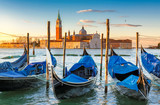 Venice sunrise. Gondolas by Saint Mark square with San Giorgio di Maggiore church in Venice, Italy,