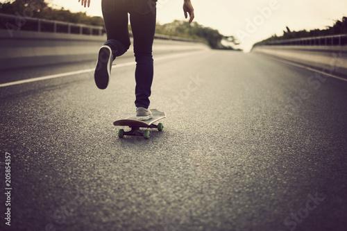 Plexiglas Skateboard Skateboarder skateboarding on city street